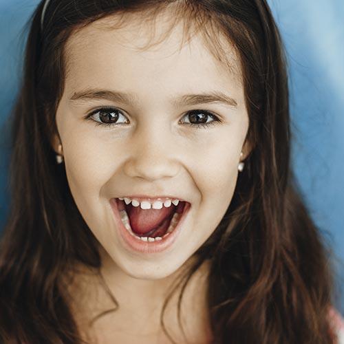 little girl smiling after dental checkup